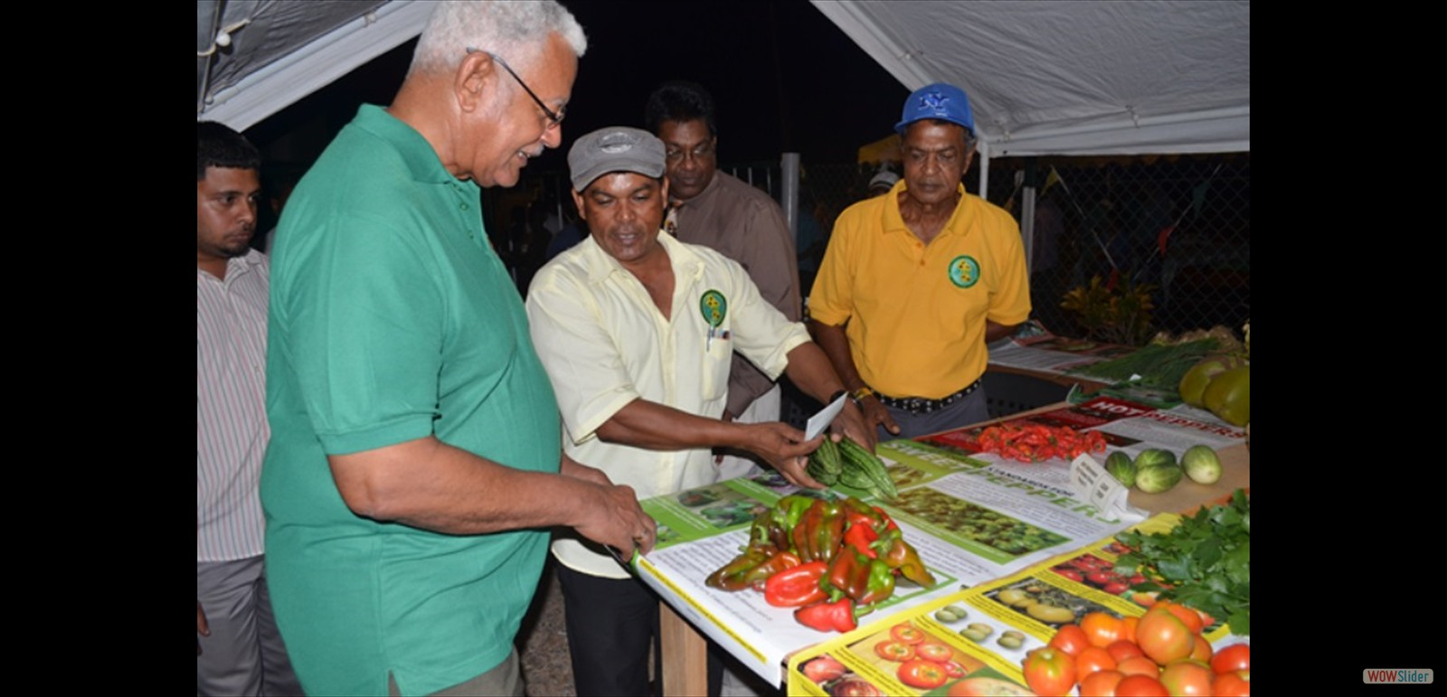 Agriculture Minister Noel Holder during his visit to one of the many booths at the MMA open day exhibition