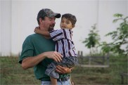 The late Rodney Hawbaker in 2010 with Wilson, one of the children at Andrea's Home of Hope and Joy, where Hawbaker was instrumental in starting the Bolivian dairy project. It is now entering its next phase named in Hawbaker's honor as Warm Spring Farm. Photo by Karen Hawbaker