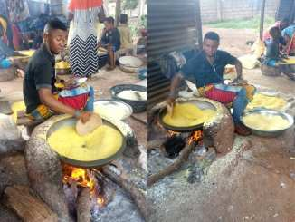 A young man roasting garri
