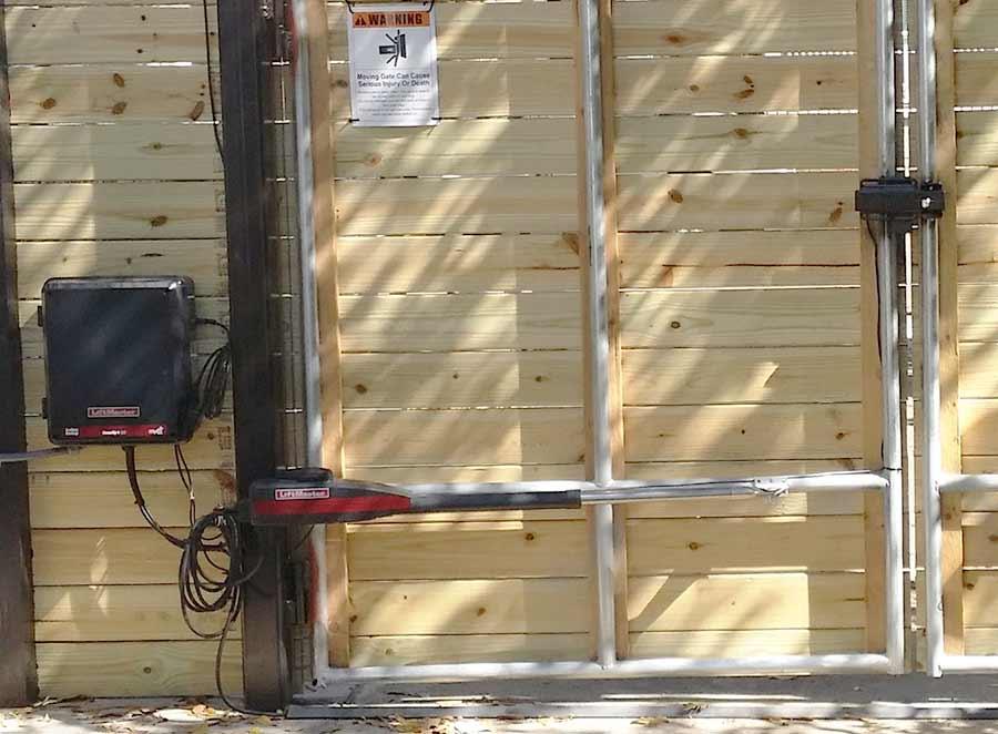 Duo Wood Swing Gate near Audubon Park. Powered by Lift Master.