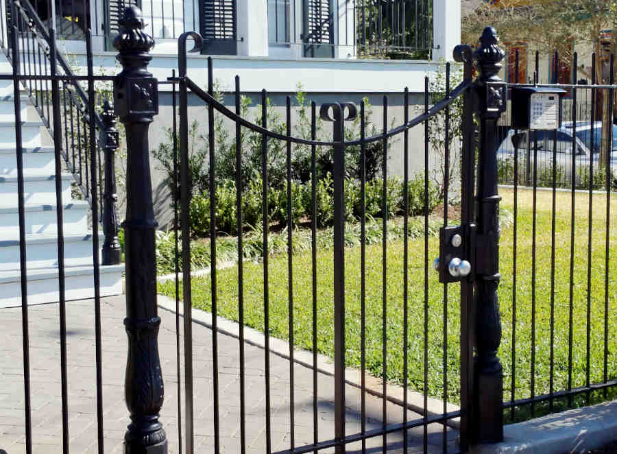 Sliding Gate Entrance with a Telephone Access System for an Uptown Home.