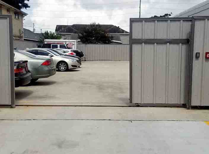 Automatic Sheet Metal Gate that Secures a Parking Lot in New Orleans East.