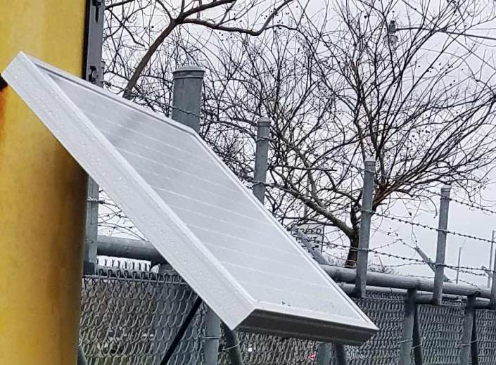 Solar Panel on Chain Link Fence in Central City.