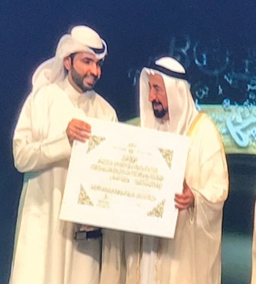 Abdullah al-Busais receiving the Best Arabic Novel Award at the 2017 Sharjah Book Fair (Abdullah al-Busais)