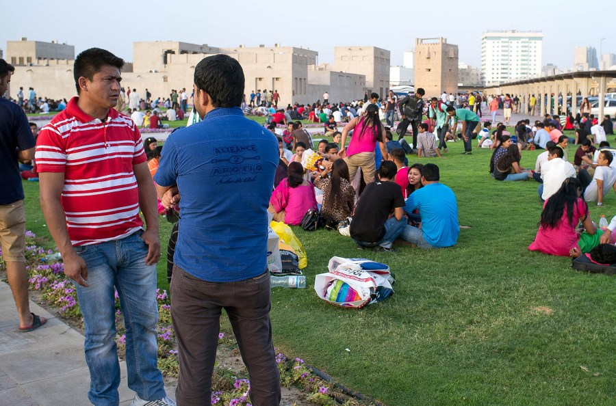 Nepalese workers at Al Ghubaiba metro station park in Dubai