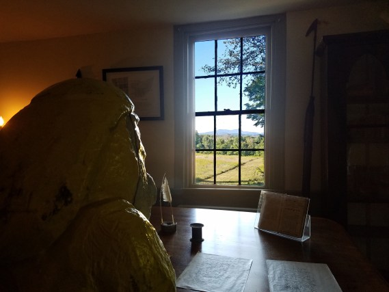 Captain Ahab of Ahab's Adventures looking out the famous window at Herman Melville's Arrowhead part of the Berkshire Historical Society 2016