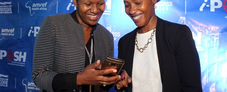Nellie Keriri, PharmAccess and Dr Frasia Karua, Amref Health Africa interact with mhealth solutions at i-PUSH launch