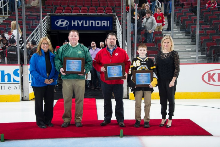 (Pictured Left to Right) Alexandra Dousmanis-Curtis, BMO Harris Bank, Volunteer - Tom Cotter, St Patrick High School, Coach - Willis Griffin, Hinsdale Central JV, Player - Cole Walsh, Joliet Jaguars, Annie Camins, Chicago Blackhawks Youth Hockey Director