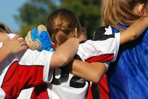 Girl's youth soccer team in a huddle