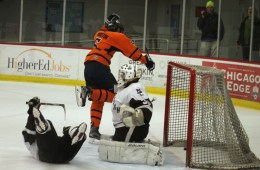 Forward #5 Harrison Proctor reacts to his shot getting past Mt. Carmel's goalie.