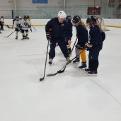 Dan Jablonic (USAH ADM Regional Manager) and Heather Mannix (USAH ADM Regional Manager of Female Hockey) with the Sabre Girls 10U team at All Seasons Ice Rinks.