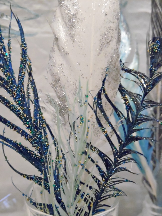 Image showing finished painted glitter feathers from tutorial
