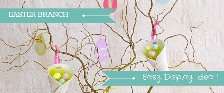 Curly Willow Twigs in A Glass Vase Displaying Cute Easter Decorations