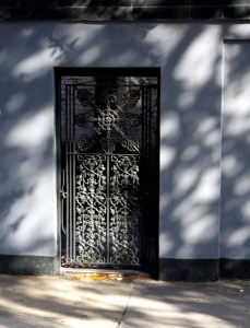 Love the grill work on this courtyard gate