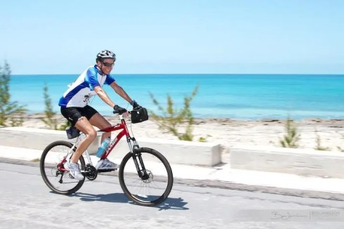 Smiles form a 100 miler as she powers past the stunning Eleuthera backdrop