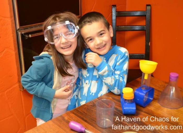 Sarah's daugther, 7 yrs. old, and son, 6 yrs. old, posing next to their science kit.