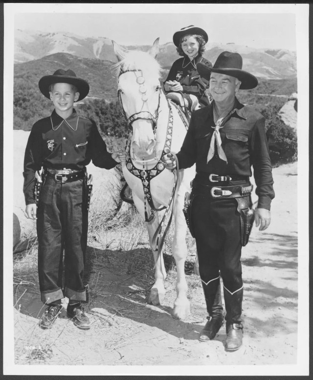 Hopalong Cassidy with children in Hoppy costumes and his horse,Topper. Photofile: William L. Boyd.  UW American Heritage Center.