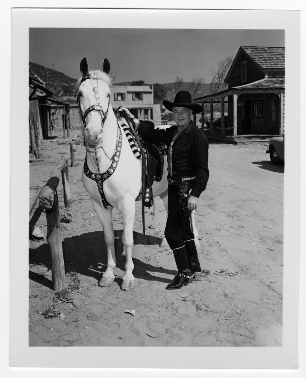 Photo of Hoppy with his horse, Topper, from the William Boyd Papers, #8038, Box 115, Folder 1. UW American Heritage Center.
