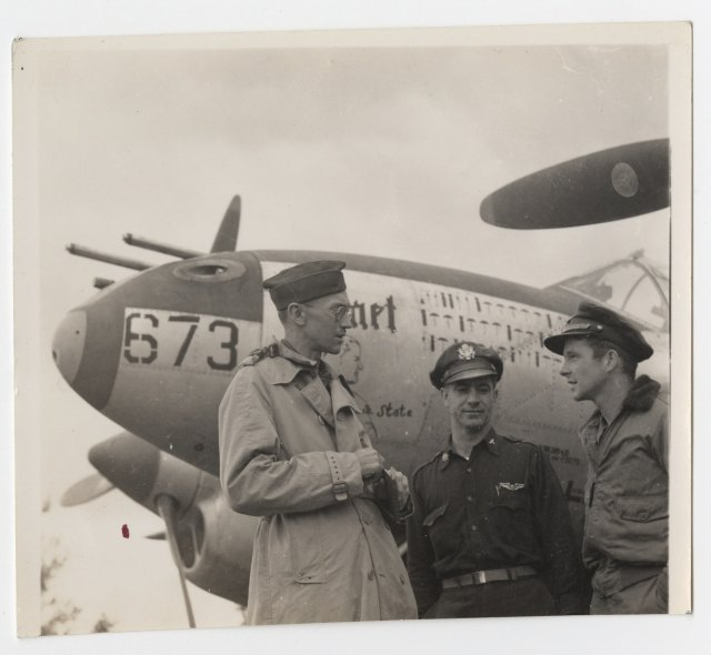 Reporter and combat photographer Richard Tregaskis chatting with fighter pilots during WII. Richard Tregaskis papers, #6346, Box 4, Folder 16. University of Wyoming, American Heritage Center.