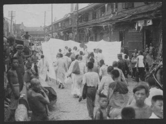 Chinese street scene, ca. mid-1920s, Irene Kuhn Papers, Collection #8536, Box 26, Folder 6. American Heritage Center, University of Wyoming.