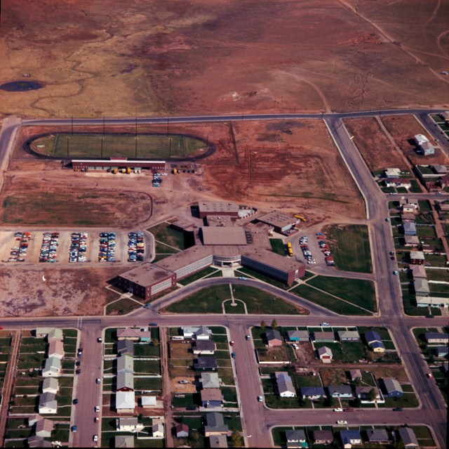 Color photo showing an aerial view of the former Laramie High School looking east.