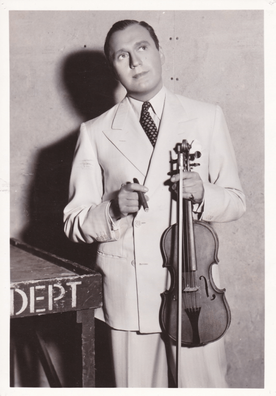 portrait of a man in a suit holding a cigar and violin
