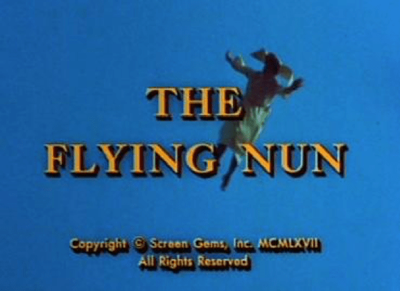 "image with ""The Flying Nun"" text and nun flying in sky in background"