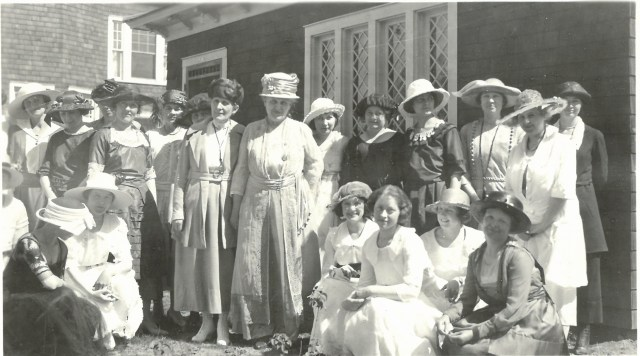 Grace Raymond Hebard and Carrie Chapman Catt, and several other women posing for a photo outside. Probably taken in 1921 when Catt was in Laramie to accept an honorary doctorate from the University of Wyoming.