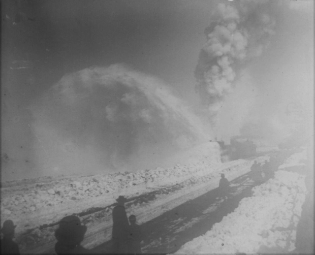 train plowing through snow in Laramie, Wyoming in 1896