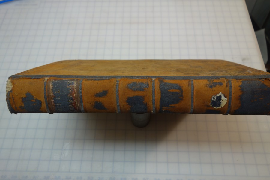 The British Herbal book spine with black residue on spine
