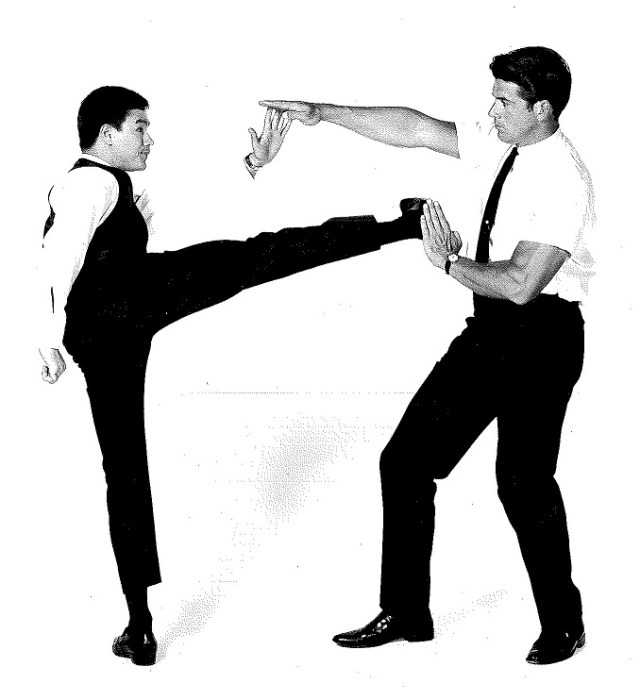 Bruce Lee shows Van Williams some kung fu fighting techniques in this publicity photograph, 1966. William Dozier papers, UW American Heritage Center.