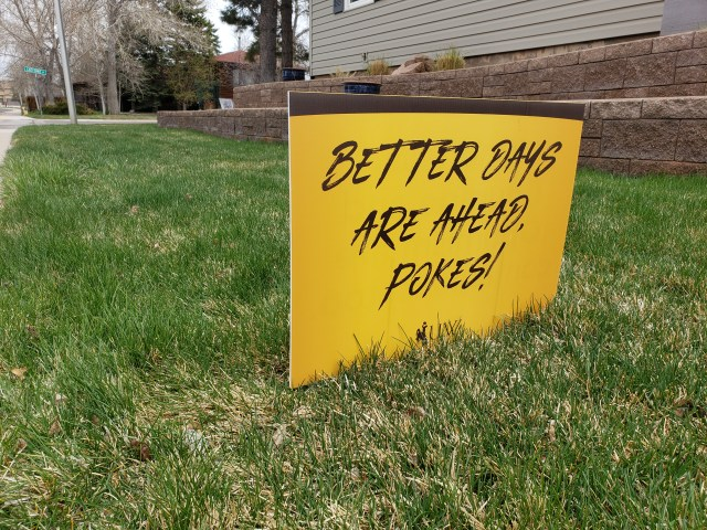 "UW yard sign found on lawn in Laramie, Wyoming. that reads ""Better Days Are Ahead Pokes!"" in response to the Covid-19 pandemic. Photo taken by AHC Archivist Sara Davis."