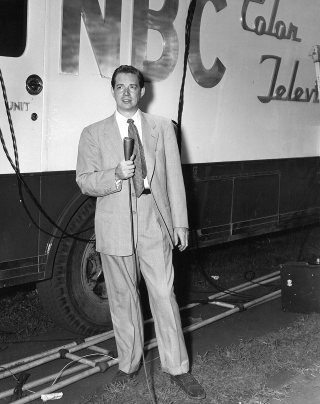 Hugh Downs standing next to an NBC TV van, ca. 1962.