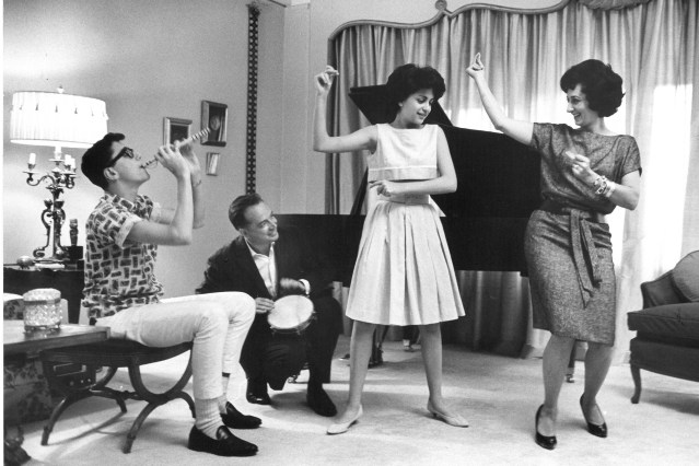 Hugh Downs, son H.R., daughter Deirdre, and wife Ruth having a musical evening in the publicity photograph from the 1960s.