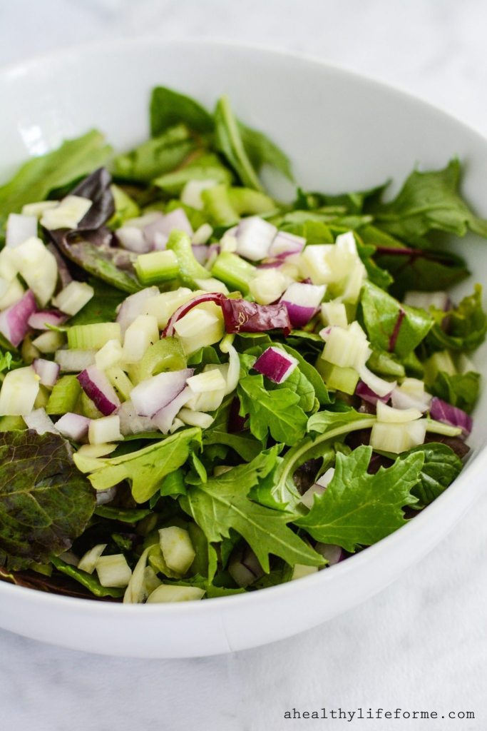Chopped Italian Salad is loaded with crunchy raw vegetables and topped with a light lemon vinaigrette. The perfect all around healthy salad. Gluten Free, Paleo Friendly, Dairy Free, and Whole 30.
