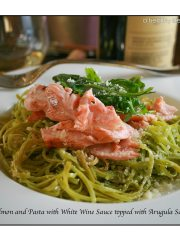 Salmon and Pasta with a White Wine Sauce topped with Arugula Salad