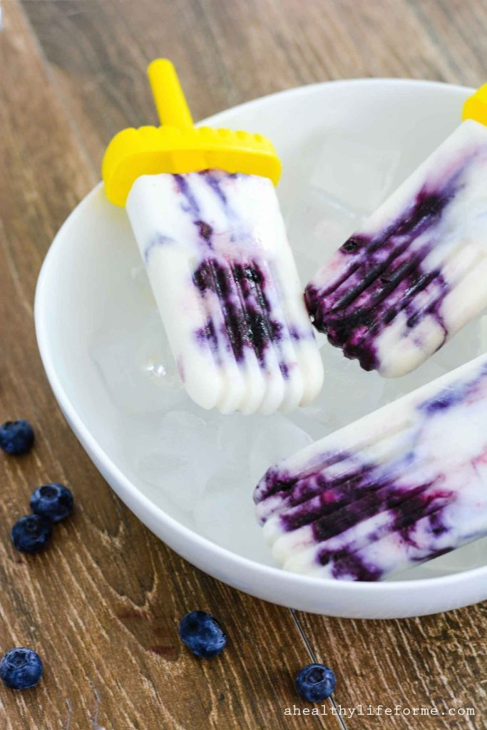 Blueberry Cream Pops are filled with fresh blueberries coconut cream and sweetened with maple syrup.  Simple cool summer treat | ahealthylifeforme.com