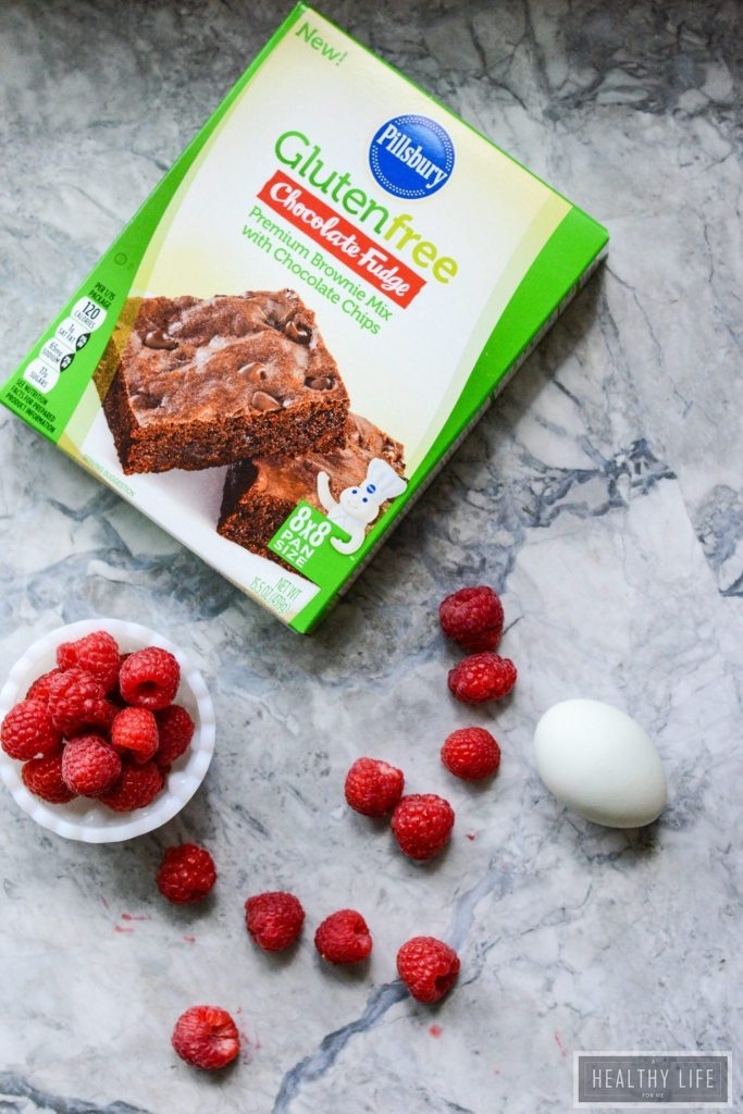 These Gluten Free Double Chocolate Raspberry Brownies are a decadent moist and rich brownie with a little bit of healthy berry goodness rolled up inside and thrown on top   ahealthylifeforme.com