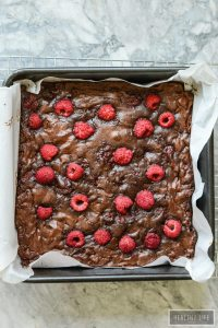 These Gluten Free Double Chocolate Raspberry Brownies are a decadent moist and rich brownie with a little bit of healthy berry goodness rolled up inside and thrown on top | ahealthylifeforme.com