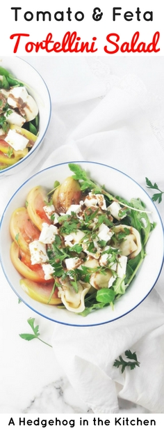 This tomato feta tortellini salad is a perfect healthy picnic staple. YUM. Just 8 simple ingredients & 10 minutes to pull together! | ahedgehoginthekitchen.com