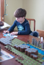 Colin learning the new game (heroscape)