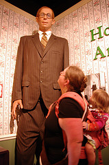 Next to a statue of Robert Pershing Wadlow