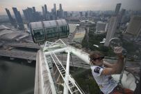 "French climber Alain Robert, also known as ""Spiderman"", scales the 165-metre-high (541-feet) Singapore Flyer observation wheel in Singapore November 5, 2010. REUTERS/Vivek Prakash"