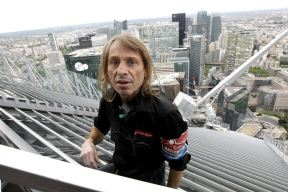 """French climber Alain Robert, also known as """"Spiderman"""", scales the 231 metre First Tower at the La Defense business district outside Paris May 10, 2012. REUTERS/Benoit Tessier 11 / 20Share to FacebookShare to TwitterShare to Pinterest ClosePrevious imageNext image"""