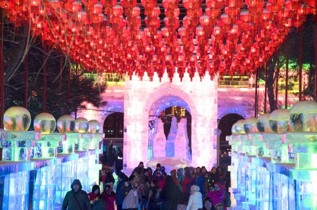 Visitors walk by ice sculptures in the Zhaolin park at the 30th Harbin International Ice and Snow Sculpture Festival in Harbin, capital of China's Heilongjiang province, December 26, 2013. This ice lantern festival opened on December 26, displaying more than 2,000 ice sculptures and will last until February 2014. (EPA/STRINGER)