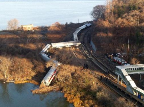 "Cars from a Metro-North passenger train are scattered after the train derailed in the Bronx neighborhood of New York, Sunday, Dec. 1, 2013. The Fire Department of New York says there are ""multiple injuries"" in the train derailment, and 130 firefighters are on the scene. Metropolitan Transportation Authority police say the train derailed near the Spuyten Duyvil station. (AP Photo/Edwin Valero)"