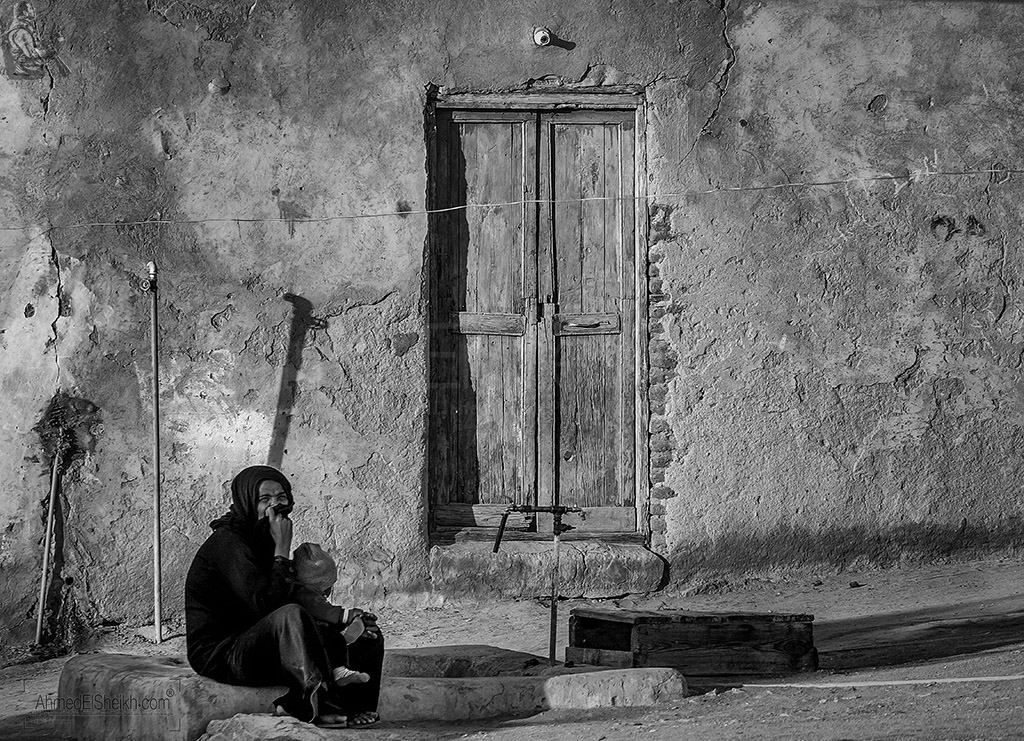 Woman sitting in front of her house in nubia
