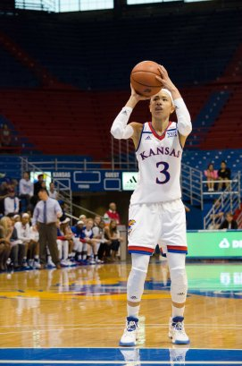 Guard Jessica Washington, a junior from Tulsa, Oklahoma, shoots a free throw during the basketball game against Fort Hays State on Oct. 30. KU won 98-71. Ashley Hocking/KANSAN
