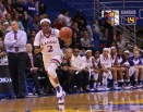 Sophomore McKenzie Calvert, a guard from Schertz, Texas, maintains control of the ball during the women's basketball game at Allen Fieldhouse on Nov. 23 against Oral Roberts University. The Jayhawks won 64-56. Ashley Hocking/KANSAN