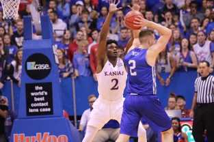 Guard Lagerald Vick, a sophomore from Memphis, Tennessee, blocks UNC Asheville player Alec Wnuk during the game on Nov. 25. Kansas beat UNC Asheville 95-57 at Allen Fieldhouse. Ashley Hocking/KANSAN